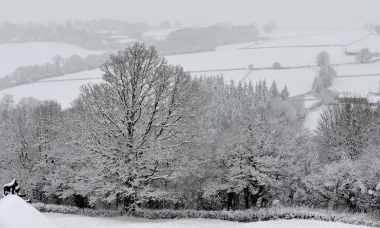 The pretty snow-covered countryside in the hills near Longtown, Herefordshire