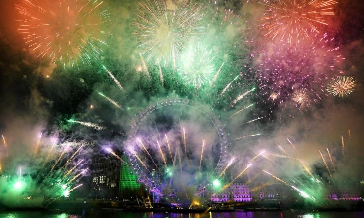 Fireworks fall across the London skyline during New Year's Eve celebrations.