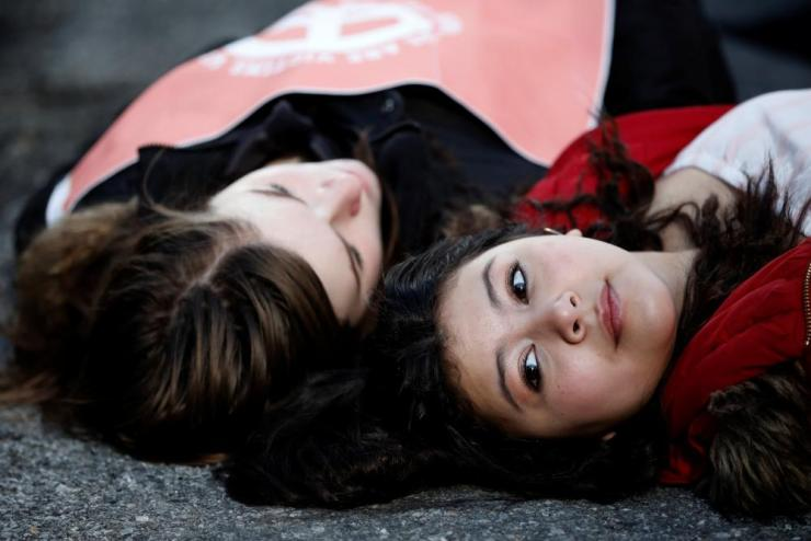 Students from Fiorello H. Laguardia High School lie down on West 62nd in Manhattan.