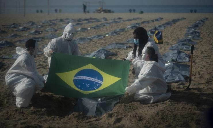 A group stage a demonstration to remember the 400,000 deaths by Covid-19 in Brazil, in Praia do Leme, next to Copacabana Beach, in Rio De Janeiro.