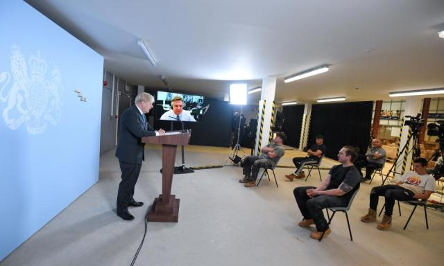Boris Johnson responding to a question from Andy Bell (pictured on the large TV screen).