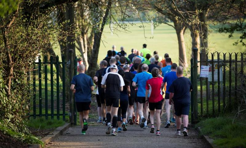 runners in a group in a park