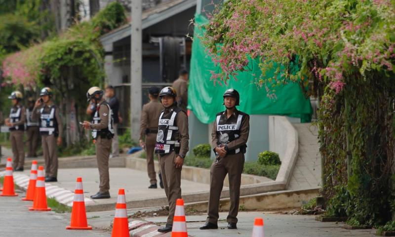 Thai police officers stand guard outside the hospital in Chiang Rai province.