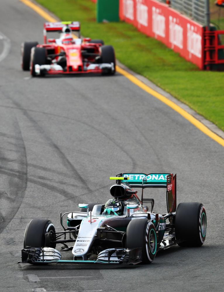Nico Rosberg of Germany takes a corner ahead of Kimi Raikkonen of Finland.