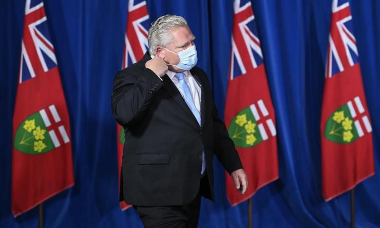 Ontario Premier Doug Ford holds a press conference at Queen's Park during the Covid-19 pandemic in Toronto on Monday, 21 December 2020.