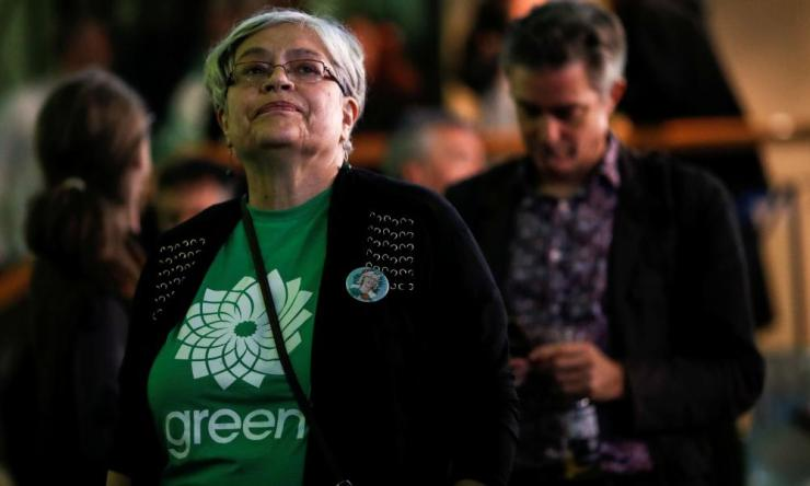 A Green Party supporter reacts while observing the live federal election results in Victoria, British Columbia.