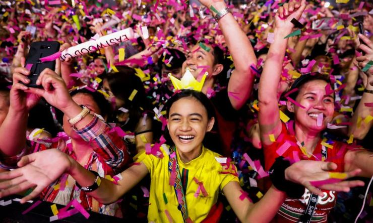 A reveller celebrates as confetti falls during a New Year's Eve party in Quezon City, Metro Manila, Philippines January 1, 2020.