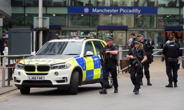 Armed police outside Manchester Piccadilly station after a suicide bomber killed 22 people leaving a pop concert at Manchester Arena on Monday night
