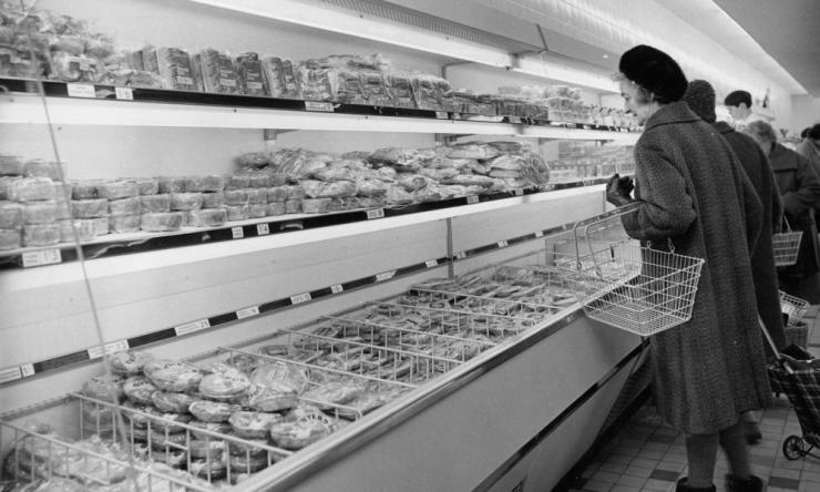 Shoppers look at foodstuffs on show in refrigerated cabinets at the newly-opened Sainsbury's supermarket at Sutton, Surrey, 1960.