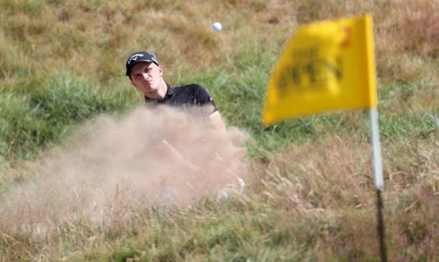 England's Ashton Turner chips out of a bunker on the 2nd.