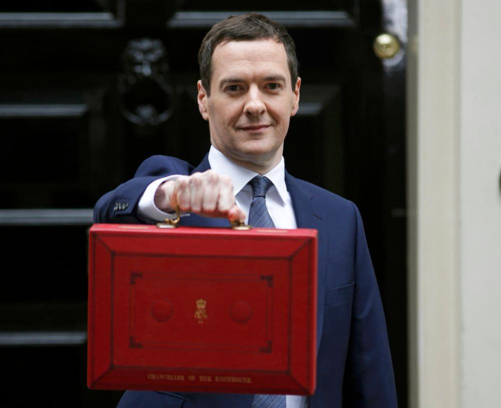 Britain's Chancellor George Osborne holds up his budget case as he stands outside number 11 Downing Street .