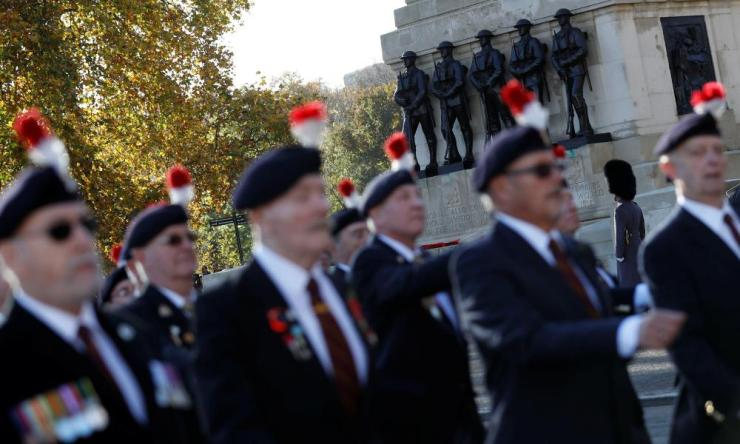 Military veterans march across Horse Guards Parade during a National Service of Remembrance at The Cenotaph in Westminster, London, Britain, November 11, 2018. REUTERS/Peter Nicholls