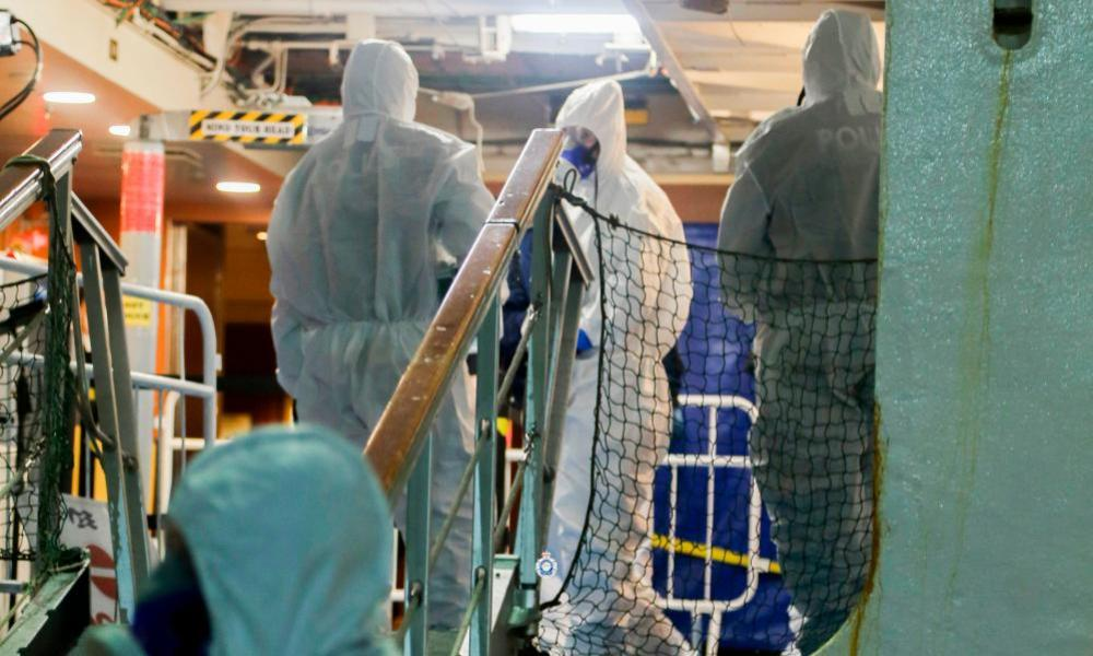 This handout photo taken and released on April 9, 2020 by the New South Wales Police Force shows police officers about to raid the coronavirus-stricken Ruby Princess cruise ship and seize its black box at Port Kembla, Australia.
