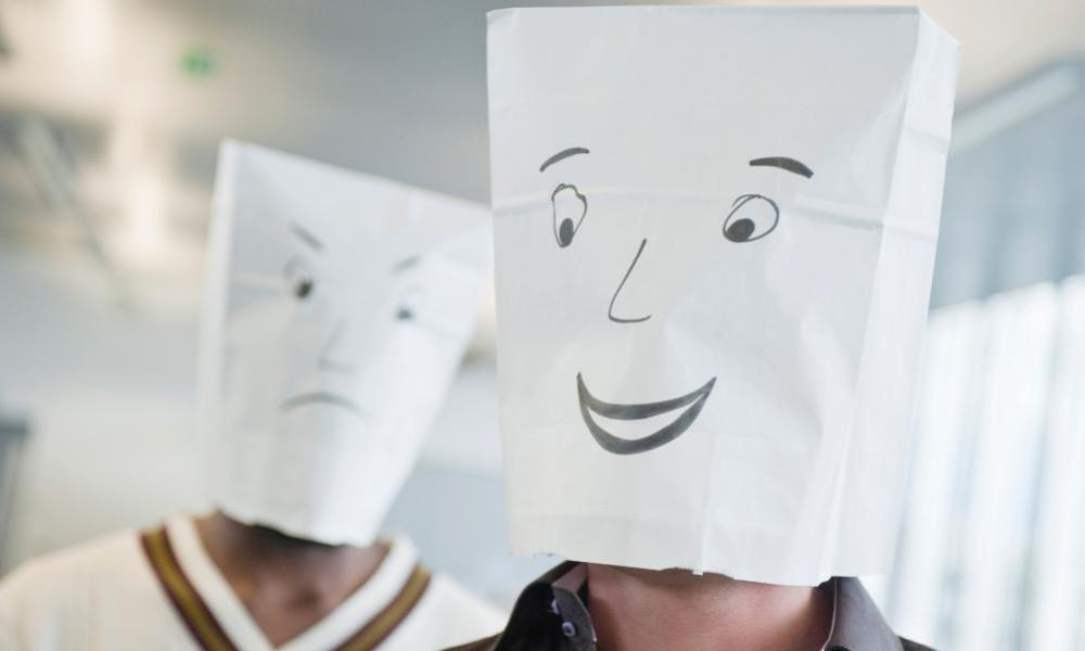 Two businessmen wearing paper bags of happy and sad facesBP6JAC Two businessmen wearing paper bags of happy and sad faces
