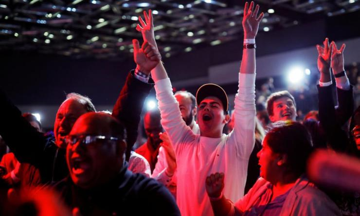 Liberal Party supporters react as they watch the live federal election results at the Palais des Congres in Montreal.