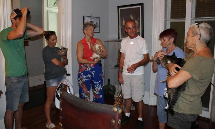 Staff of the Hemingway Home Museum with some of the cats.
