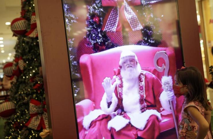 A child interacts by video with Santa Claus at NorteShopping mall in Rio de Janeiro amid the Covid-19 outbreak