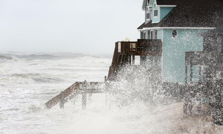 Waves batter the shoreline in Buxton on North Carolina's Hatteras Island during high tide.