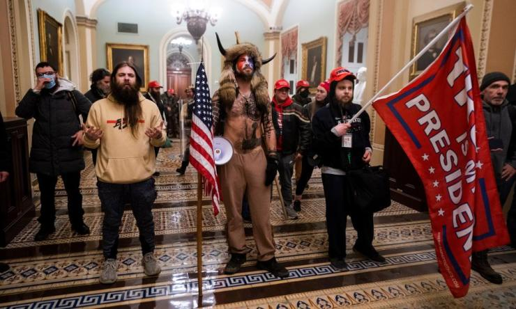 Trump supporters stand by the door to the Senate.