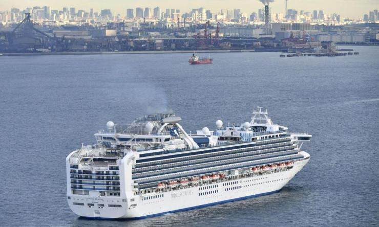 A cruise ship Diamond Princess anchors off the Yokohama Port, near Tokyo on 4 February. A person who was a passenger on the Japanese-operated cruise ship has tested positive for a new virus after leaving the ship in Hong Kong on 25 January.