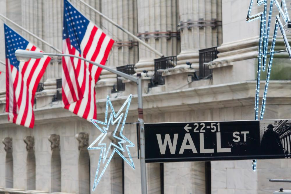 China market volatility pulls down the Dow<br>07 Jan 2016, New York State, USA --- The New York Stock Exchange behind a Wall Street street sign on Thursday, January 7, 2016. Weakness in the Chinese stock market has rippled to the U.S. pulling down the Dow giving stocks a potential for the worst start of a new year in over 100 years. (© Richard B. Levine) --- Image by © Richard Levine/Corbis