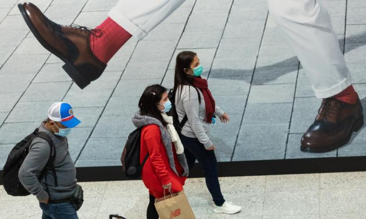 Commuters wear face masks in the Mass Transit Railway in Hong Kong.