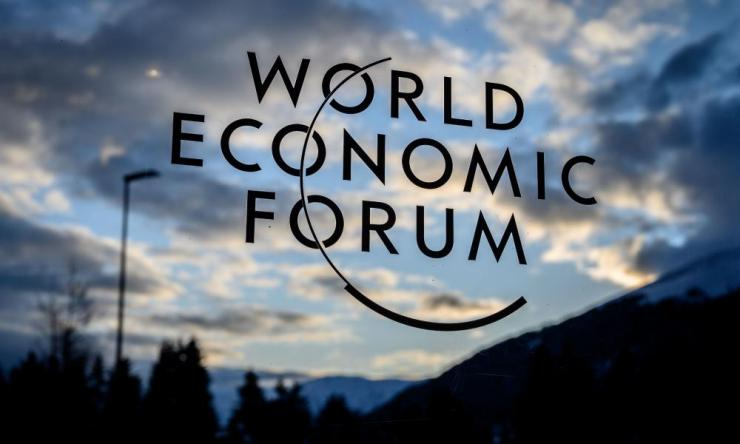 A sign for the World Economic Forum (WEF) is seen at sunset in the Congress centre ahead of the annual meeting in Davos.