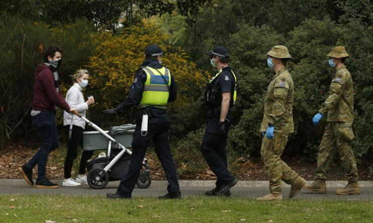 ADF personnel and Victorian police officers are seen patrolling the Botanic Gardens in Melbourne, Sunday, 26 July 2020.