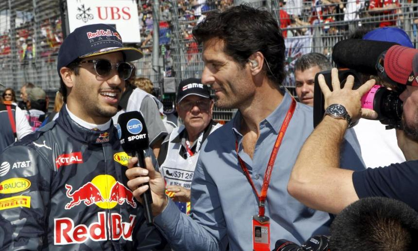 Red Bull Racing F1 driver Daniel Ricciardo (L) talks with former F1 driver Mark Webber at Albert Park.