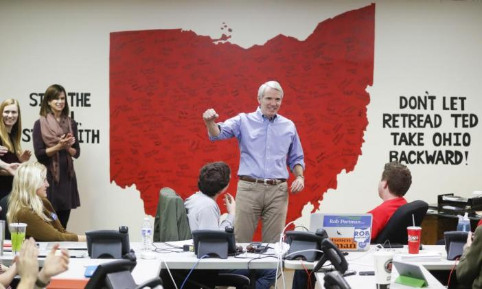 Rob Portman, R-Ohio speaks to volunteers at a phone bank for his reelection campaign, Monday, Nov. 7, 2016, in Columbus, Ohio.
