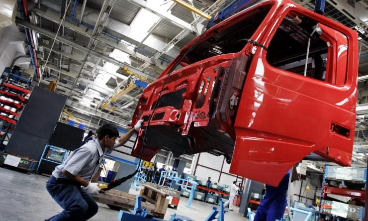 An Indian employee works on the assembly line at the Volvo factory in Hoskote, south of Bangalore.