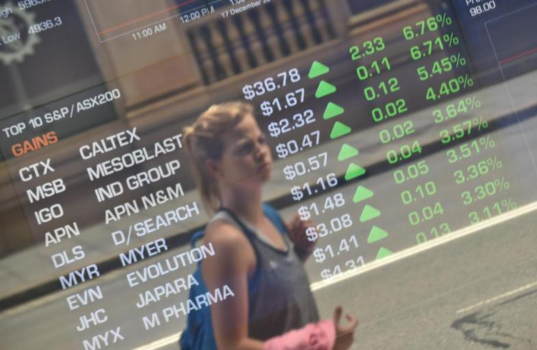 The window of the Australian Securities Exchange in Sydney, where the main share index closed 1.5% higher