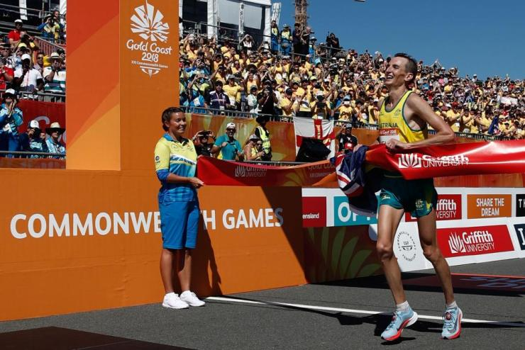 Australia's Michael Shelley crosses the finish line to win the athletics men's marathon final during the 2018 Gold Coast Commonwealth Games.