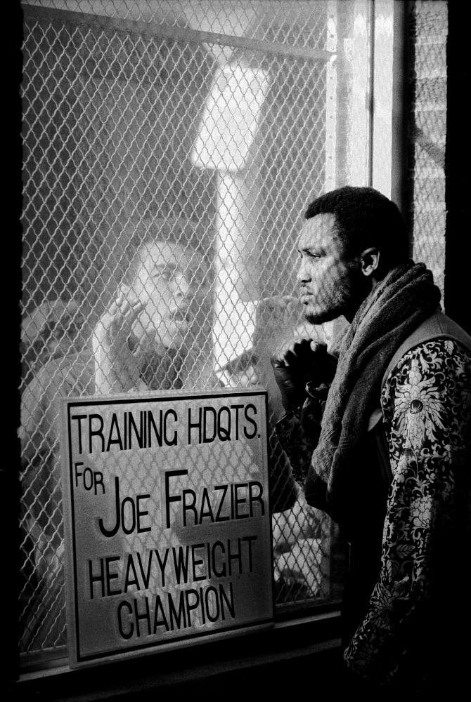Muhammad Ali (taunts rival boxer Joe Frazier at Frazier's training headquarters, Philadelphia, Pennsylvania, early 1971.