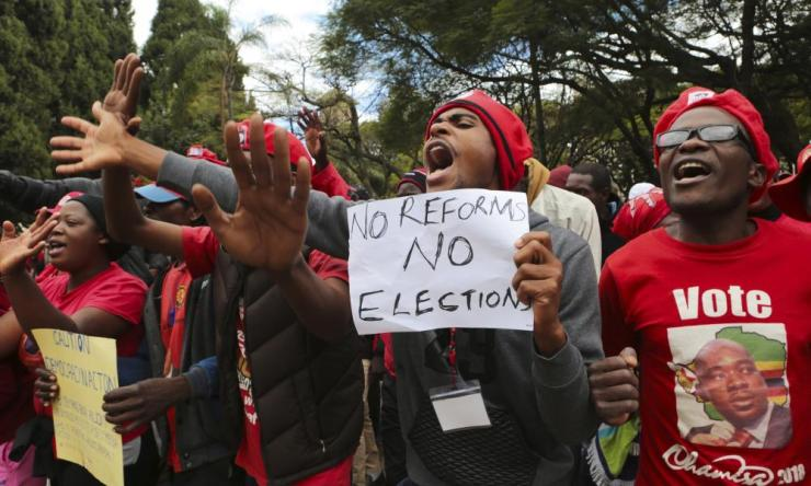 Opposition supporters march on the streets of Harare, Zimbabwe