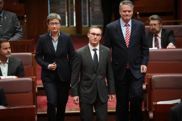 The South Australian independent senator Tim Storer arrives with Mathias Cormann and Penny Wong to be sworn in this morning in the Senate chamber