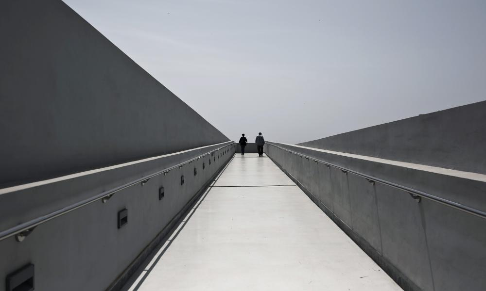 Visitors walk on a corridor leading to the top of the new National Museum of Contemporary Art in Athens.