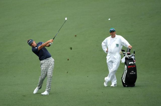 Poulter hits his approach to the 9th.