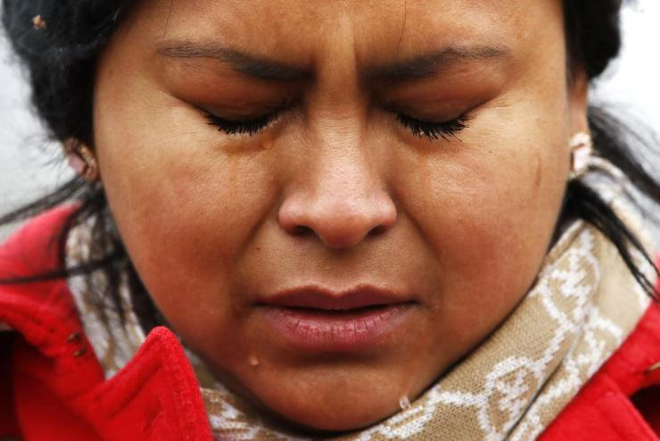 Maricruz Abarca, of Baltimore, a Daca recipient originally from Mexico, cries during a prayer with other supporters.