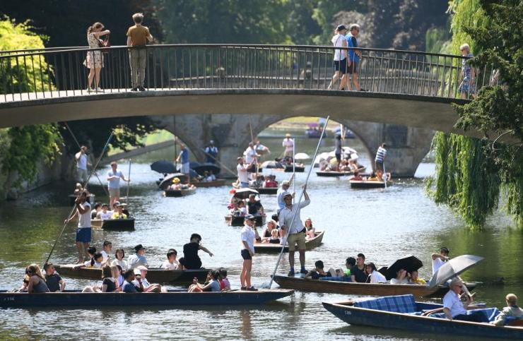 People punt along the River Cam in Cambridge.