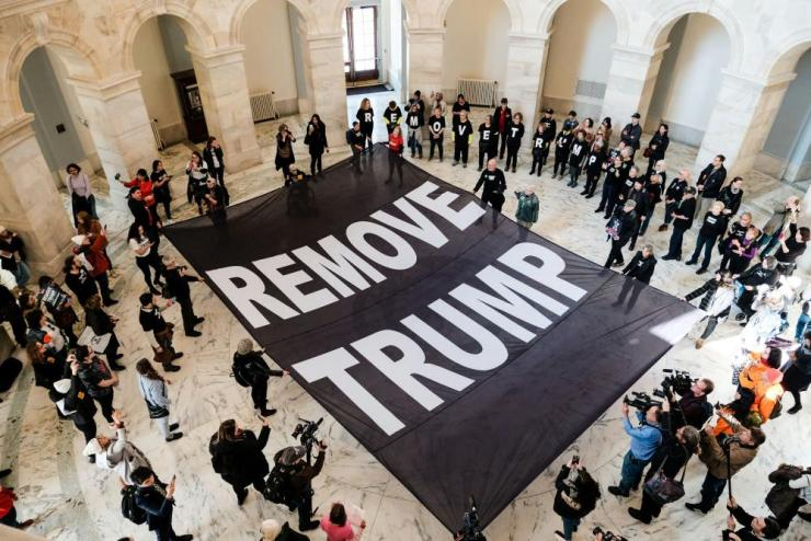 Protesters inside the Senate building call for Donald Trump's removal.