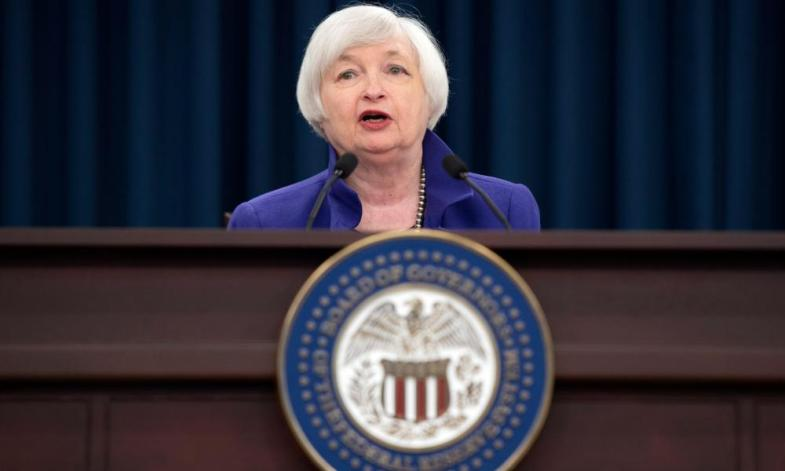 Chair of the Board of Governors of the Federal Reserve, Janet Yellen, announces that the Federal Reserve is raising its benchmark interest rate.