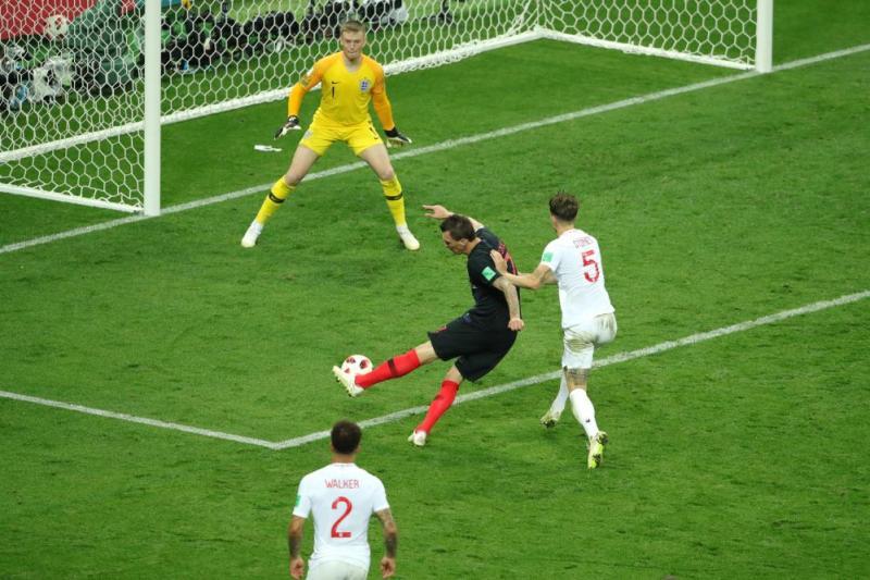 Mario Mandzukic of Croatia scores past England keeper Jordan Pickford.