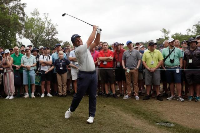 Molinari hits from the rough on the 5th.