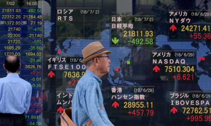 A stock indicator in Tokyo today, where shares fell by over 2%.