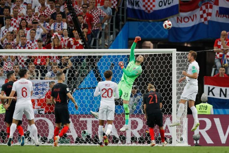 Croatia keeper Danijel Subasic punches the ball clear.