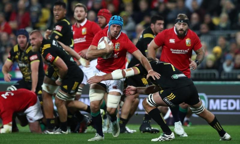 Justin Tipuric of the Lions is tackled by Callum Gibbins of the Hurricanes.