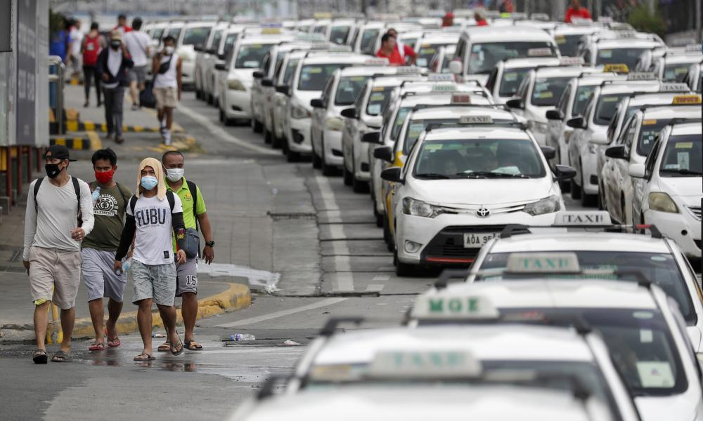 "Rows of taxis that were instructed by police to stop operations while the government implements the ""enhanced community quarantine"" as a precautionary measure against the spread of the new coronavirus in Metro Manila, Philippines, early Tuesday, March 17, 2020."