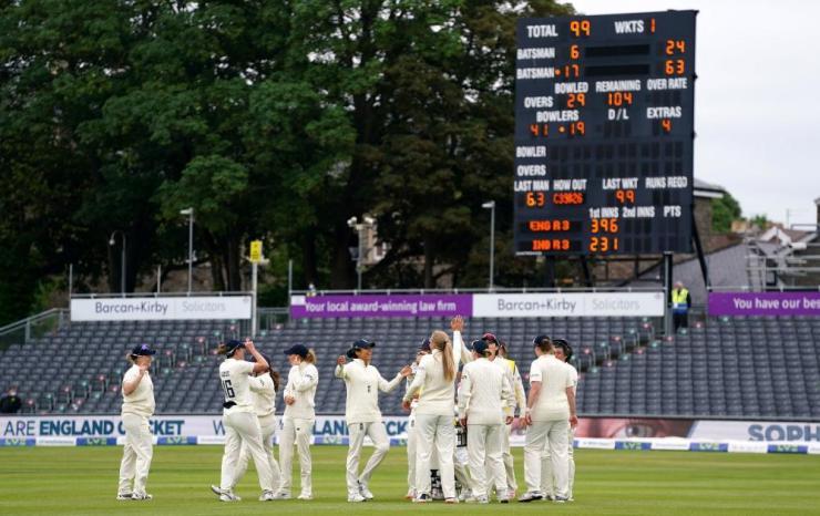 England's players celebrate Katherine Brunt's catch.