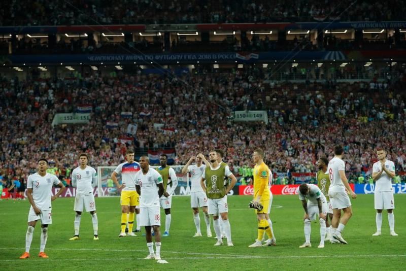 England players look around the stadium as their World Cup hopes end.